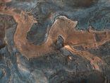 """ناسا ترصد """"تنينا ضخما"""" على سطح المريخ في صورة مذهلة!"""